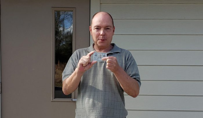 Jamie Shupe obtaining a new military ID card with male sex designation in February 2019. (Photo: Jamie Shupe)