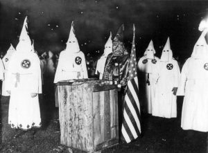 1024px-KKK_night_rally_in_Chicago_c1920_cph.3b12355