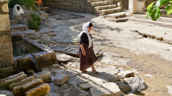 Shoes are forbidden in Lalish, Iraq, even when outdoors, to preserve the sanctuary's purity.