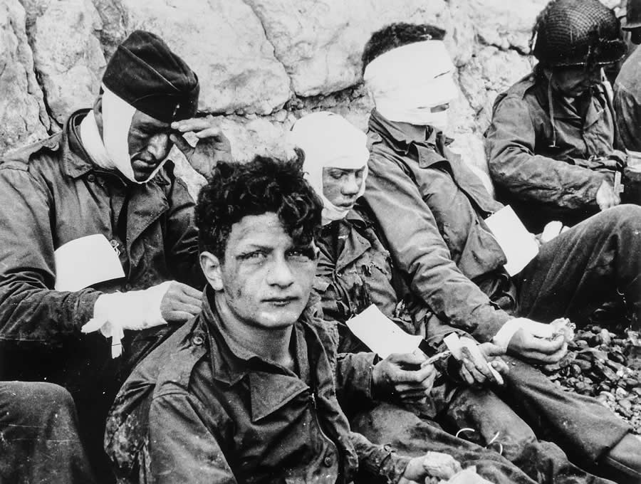 American Assault Troops of the 16th Infantry Regiment, Injured While Storming Omaha Beach, Wait by the Chalk Cliffs for Evacuation to a Field Hospital for Further Medical Treatment, Collville-sur-Mer, Normandy, France, June 6, 1944.
