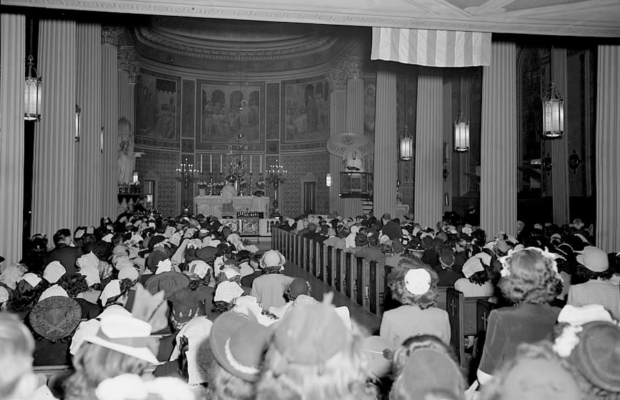 June 6, 1944 — Noon mass at Saint Vincent de Paul's Church in New York, New York.