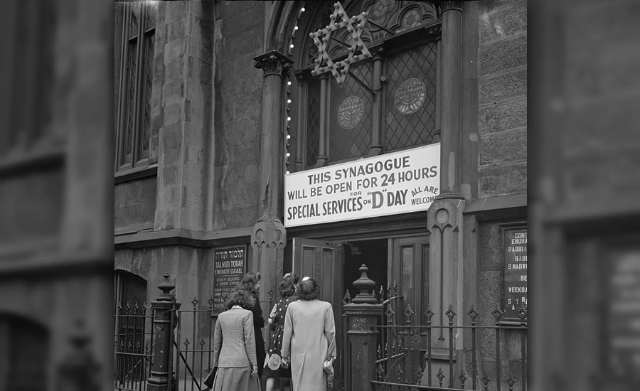 June 6, 1944 — A group of women enters the synagogue on West Twenty-third Street in New York, New York, which stayed open all day on D-Day.