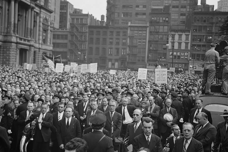 June 6, 1944 — A crowd on D-Day in Madison Square, New York, New York.