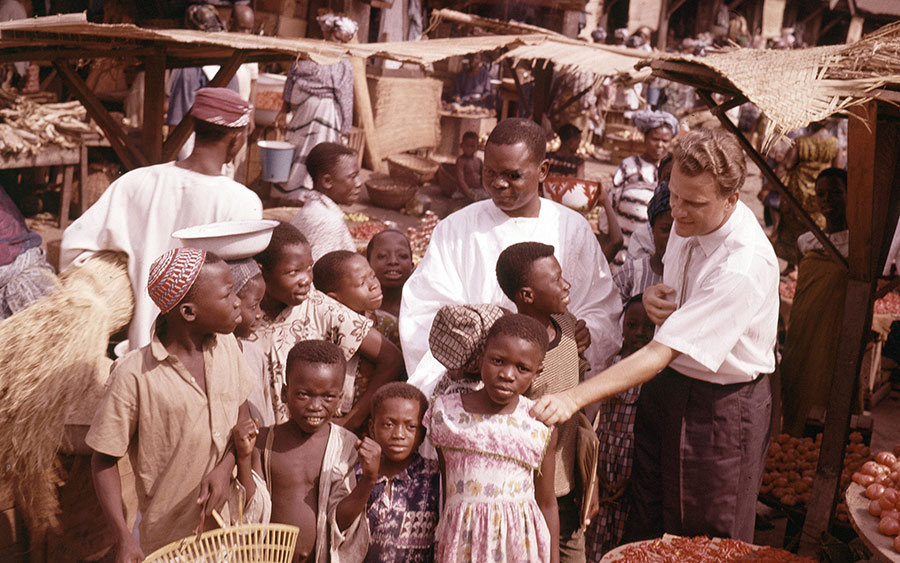 Billy Graham is shown with children during a visit to a village in Ghana, Jan. 1960.