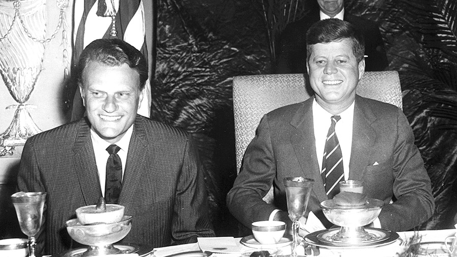 US President John F. Kennedy sits with Christian evangelist Billy Graham at the National Prayer Breakfast, Washington DC, February 9, 1961.