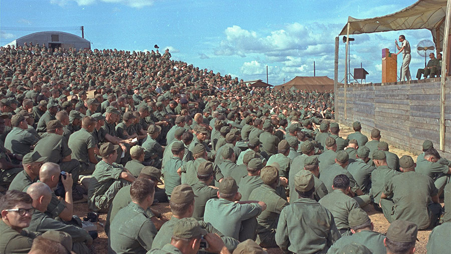 Billy Graham speaks a crowd of more than 5,000 U.S. troops at Long Binh, Vietnam, December 23, 1966.