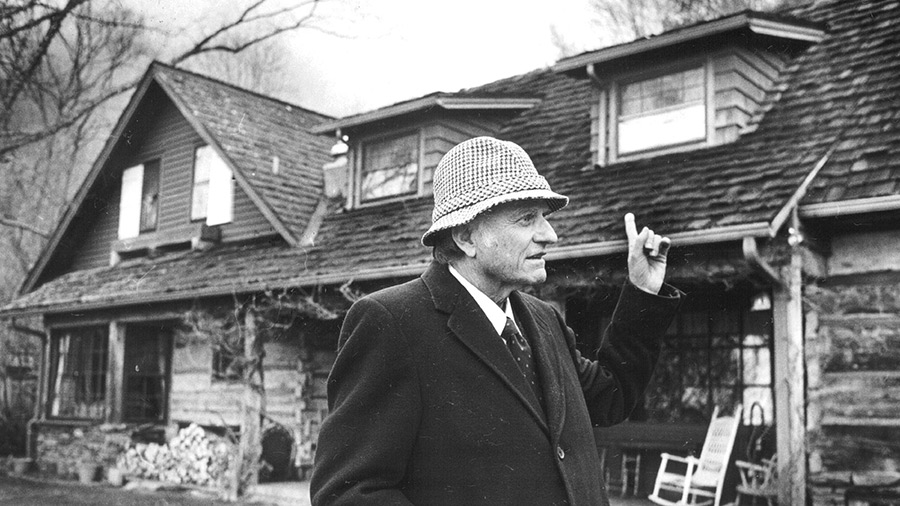 APR 19 1987: Billy Graham in the back yard of his home in Montreat North Carolina. His home was made from two old log cabins.
