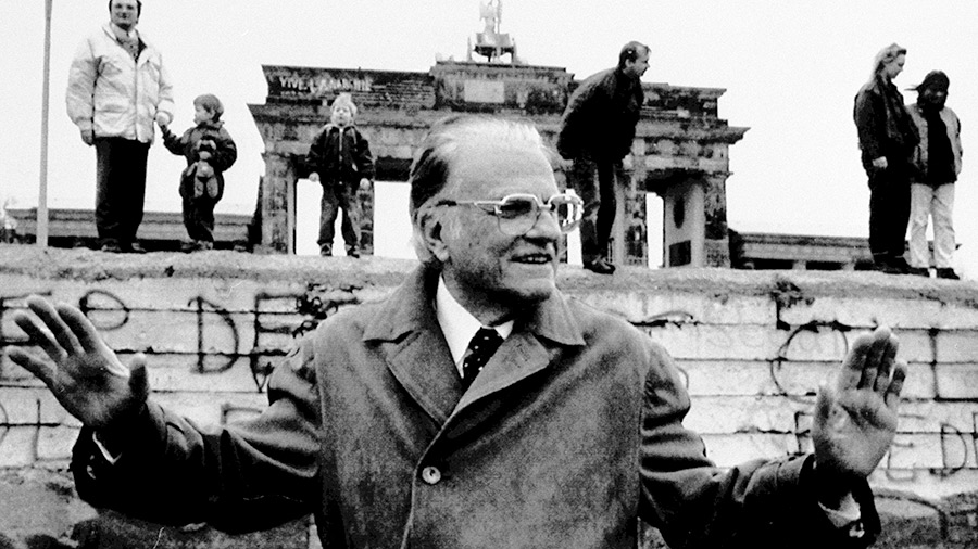 Billy Graham poses in front of the Brandenburg Gate, March 8, 1990. Graham stayed in Berlin for a rally he held by the Berlin Wall in front of the Reichstag.