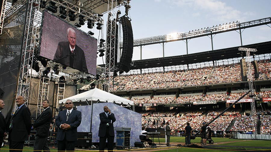 Billy Graham preaches during the Metro Maryland 2006 Festival on July 9, 2006 at Oriole Park at Camden Yards in Baltimore, Maryland. Franklin Graham, son of Billy Graham, led the three-day-program filled with music, prayers and gospel messages.