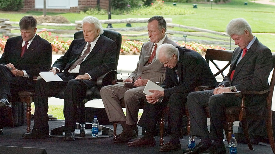 Franklin Graham, Billy Graham, and former U.S. Presidents George H. W. Bush, Jimmy Carter and Bill Clinton bow their heads in prayer during the Billy Graham Library Dedication Service on May 31, 2007 in Charlotte, North Carolina.