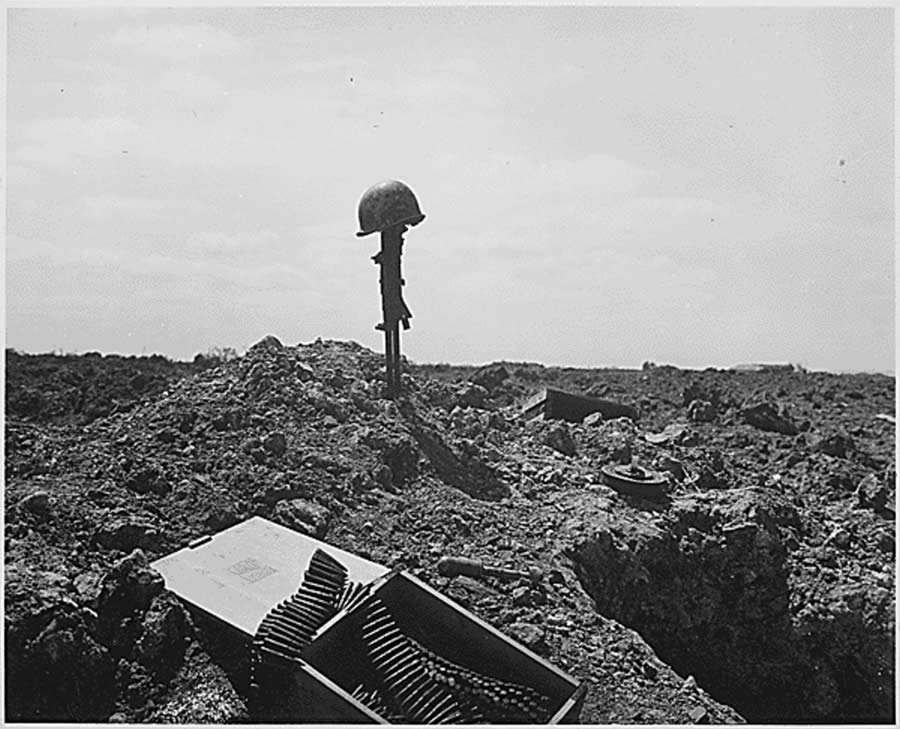 The beachhead is secure, but the price was high. A Coast Guard Combat Photographer came upon this monument to a dead American soldier somewhere on the shell-blasted shore of Normandy, ca. June 1944.