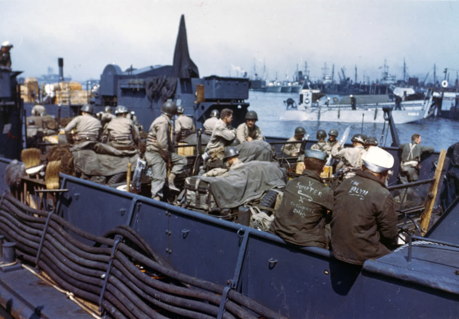 6/1944 — Original caption: View of an LCT with American troops and equipment loaded aboard awaiting the signal for the assault against the continent.