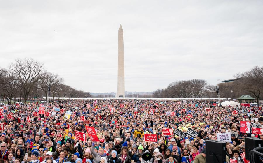 A view of the crowd from the stage, with the Washington monument in the background.