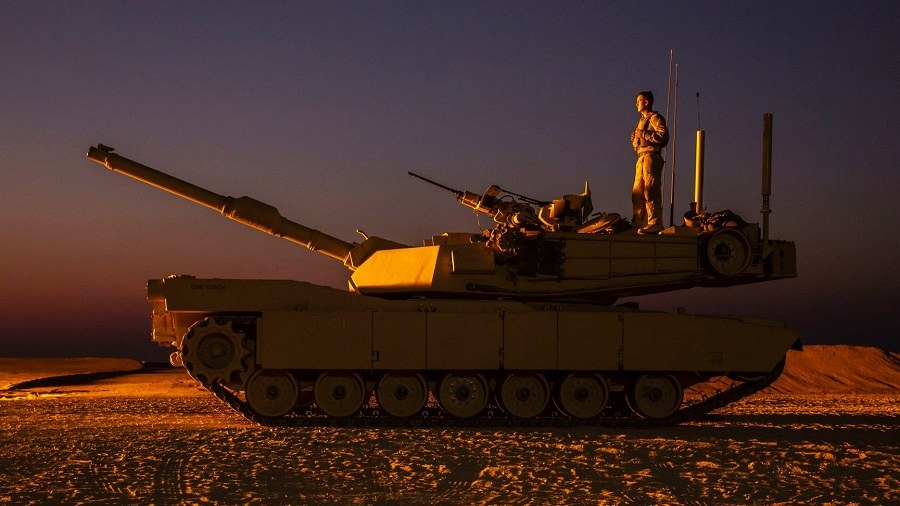 Military Photo of the Day: Standing Tall Atop an M1A1 Abrams Tank | The Stream