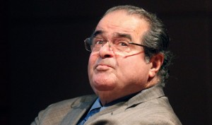 In this Oct. 18, 2011 file photo, U.S. Supreme Court justice Antonin Scalia looks into the balcony before addressing the Chicago-Kent College Law justice in Chicago. On Saturday, Feb. 13, 2016, the U.S. Marshals Service confirmed that Scalia has died at the age of 79.
