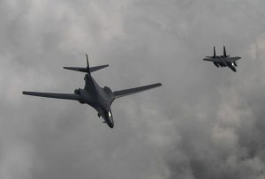In this photo provided by South Korea Defense Ministry, a U.S. Air Force B-1B bomber, left, flies with a South Korean fighter jet F-15K over the Korean Peninsula, South Korea, Sunday, July 30, 2017. The United States flew two supersonic bombers over the Korean Peninsula on Sunday in a show of force against North Korea following the country's latest intercontinental ballistic missile test. (South Korea Defense Ministry via AP)