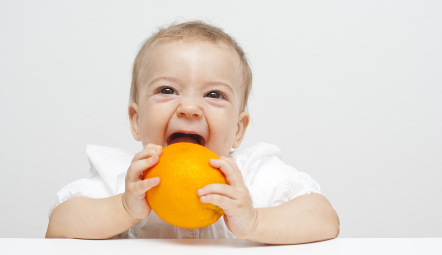 Baby Eating Orange - 900