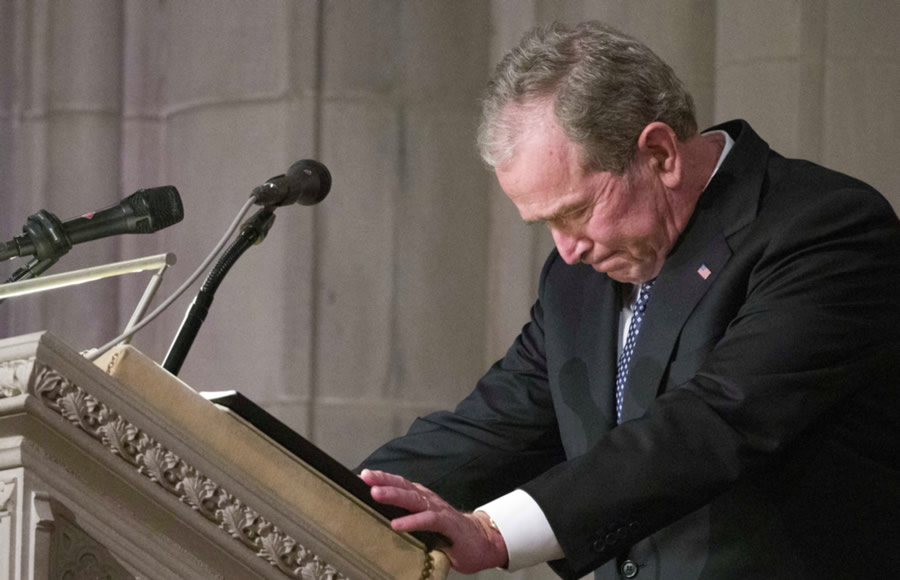 Former President George W. Bush becomes emotional as he speaks at the State Funeral for his father, former President George H.W. Bush, at the National Cathedral, Wednesday, Dec. 5, 2018, in Washington.