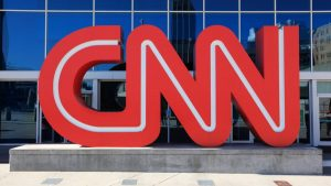 Atlanta, USA - October 19, 2011: Located in downtown Atlanta, Georgia next to Centennial Olympic Park, the CNN Center is the world headquarters of the Cable News Network (CNN). The building houses several newsrooms and studios for CNN's news channels along with this large CNN logo.