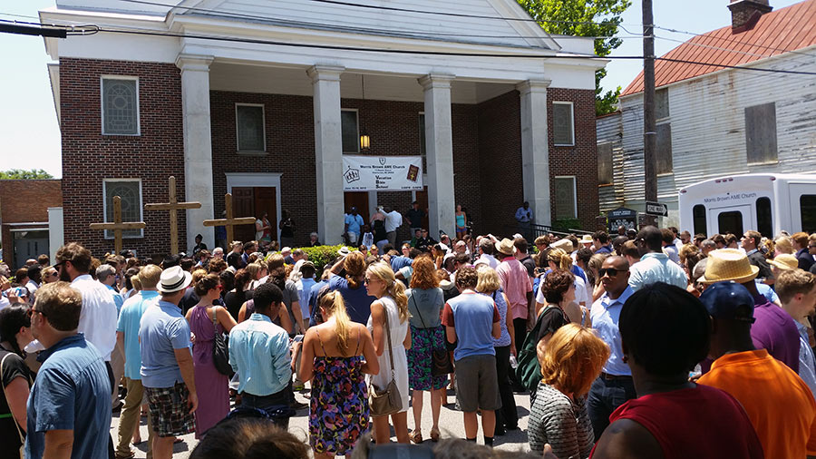 A prayer vigil at Morris Brown African Methodist Episcopal Church. As the church filled to capacity, people gathered outside, sung hymns, and listened to religious leaders talk.