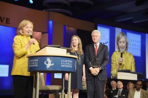 NEW YORK, NY - SEPTEMBER 24: Former US Secretary of State Hillary Clinton, Former U.S. President Bill Clinton, and their daughter, vice chair of the Clinton Foundation Chelsea Clinton take part in the Closing Plenary Session: 'Aiming for the Moon and Beyond' during the fourth day of the Clinton Global Initiative's 10th Annual Meeting at the Sheraton New York Hotel & Towers on September 24, 2014 in New York City. (Photo by Michael Loccisano/Getty Images)