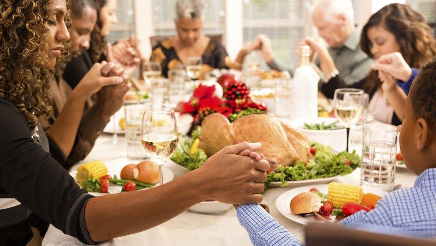 Family Praying at Christmas Dinner - 900
