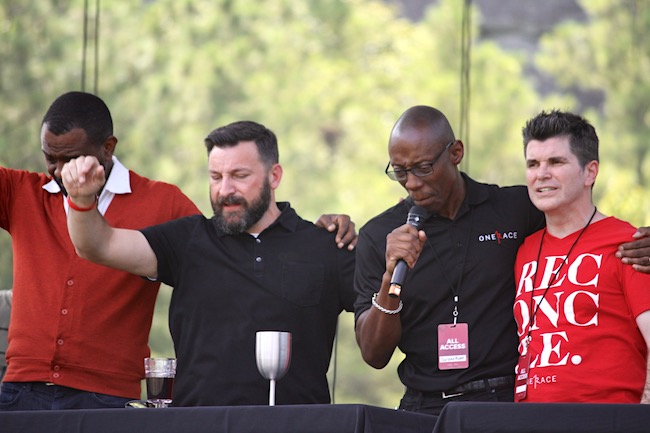 In a climatic moment of the OneRace Gathering, leaders pray before serving communion. L-R: Will Ford, Matt Lockett, Garland Hunt, Billy Humphrey.