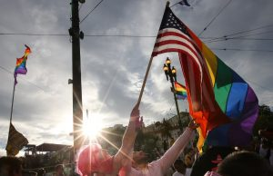 In this June 27, 2015, file photo, a woman and man wave a rainbow pride flag and an American flag in San Francisco, Calif., during a gay pride celebration following the U.S. Supreme Court's ruling that same-sex couples have a constitutional right to marry nationwide without regard to their state's laws.