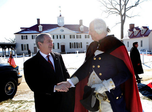 President George W. Bush shakes hands with General George Washington, played by actor Dean Malissa, following President Bush's address at the Mount Vernon Estate, Monday, Feb. 19, 2007 in Mount Vernon, Va., honoring Washington's 275th birthday.