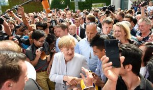 German Chancellor Angela Merkel greets members of the public at the Federal Chancellery during the 18th open day of the German Federal Government in Berlin, Germany, Sunday Aug. 28, 2016.