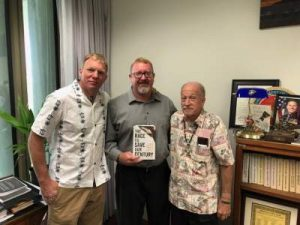 Jason Jones, Hawaii Rep. Bob McDermott, and Fr. David Barfknecht lobby for life.