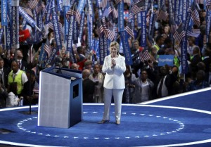 In this July 28, 2016 photo, Democratic presidential nominee Hillary Clinton reacts after speaking during the final day of the Democratic National Convention in Philadelphia. For eight summer nights, there were two starkly different visions of America at the Republican and Democratic political conventions.  (AP Photo/John Locher)