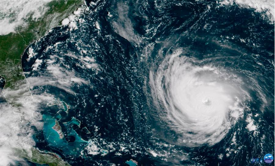 This GOES East satellite image taken Tuesday, Sept. 11, 2018, at 10:30 a.m. EDT, and provided by NOAA, shows Hurricane Florence in the Atlantic Ocean as it threatens the U.S. East Coast. Millions of Americans are preparing for what could be one of the most catastrophic hurricanes to hit the Eastern Seaboard in decades. Mandatory evacuations begin at noon Tuesday, for parts of the Carolinas and Virginia.