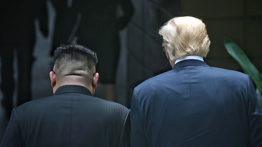 North Korean leader Kim Jong-un (L) with U.S. President Donald Trump (R) during their historic U.S.-DPRK summit in Singapore.