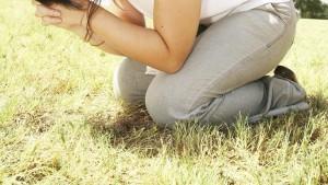 Kneeling in field Praying grass - 900