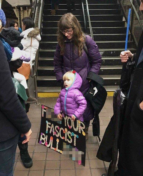 Little Girl with Profane Women's March sign - 500