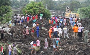 Rescuers search for survivors at the collapse of a garbage mound in Maputo, Mozambique, Monday, Feb. 19, 2018. Mozambican media say at least 17 people died when heavy rains triggered the partial collapse of the mound garbage.