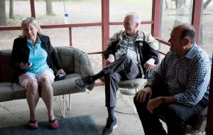 In this May 27, 2016, file photo, Pacific Legal Foundation attorney John Groen, right, speaks with Donna Murr, left, and Mike Murr, center, before a press conference at their cabin on the St. Croix River.