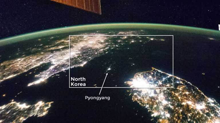 This Jan. 30, 2014, file photo shows the Korean Peninsula at night. North Korea is almost completely dark compared to neighboring South Korea, left, and China, right. The darkened land of North Korea appears as if it were a patch of water between it's neighbors. The capital city, Pyongyang, appears like a small island, despite a population of 3.26 million (as of 2008).
