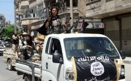 Fighters from Al-Qaeda's Syrian affiliate Al-Nusra Front drive in armed vehicles in the northern Syrian city of Aleppo as they head to a frontline, on May 26, 2015. Once Syria's economic powerhouse, Aleppo has been divided between government control in the city's west and rebel control in the east since shortly after fighting there began in mid-2012. AFP PHOTO / AMC / FADI AL-HALABI          (Photo credit should read Fadi al-Halabi/AFP/Getty Images)