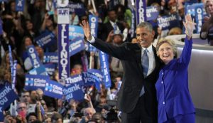 President Barack Obama and Democratic Presidential candidate Hillary Clinton wave to the crowd on the last night of the Democratic National Convention, July 27, 2016.