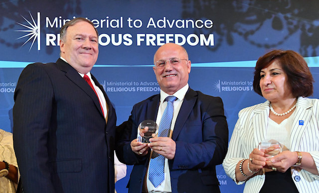 U.S. Secretary of State Michael R. Pompeo poses for a photo with William and Pascale Warda of Iraq at the 2019 International Religious Freedom Awards ceremony at the U.S. Department of State in Washington, D.C., on July 17, 2019. (Michael Gross / State Dept.)