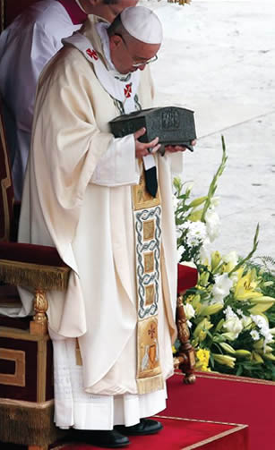 Pope Francis holds the relics of the Apostle Peter during a Mass in St. Peter's Square, November 24, 2013. Newscom, REUTERS/Stefano Rellandini
