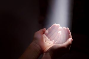 Prayer Miracles Light Beaming on Hands