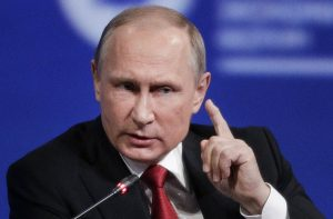 "FILE — In this Friday, June 2, 2017, file photo, Russian President Vladimir Putin gestures as he speaks at the St. Petersburg International Economic Forum in St. Petersburg, Russia. Putin is dismissing as ""a load of nonsense"" the idea that Russia has damaging information on President Donald Trump and denies having any relationship with him, said Putin in an interview with NBC's ""Sunday Night with Megyn Kelly."" (AP Photo/Dmitry Lovetsky, File)"