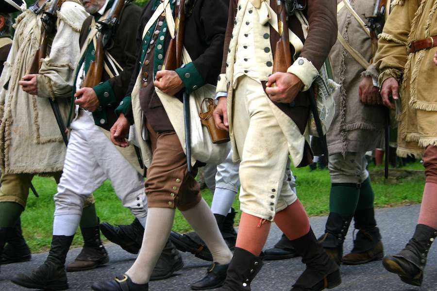 Men dressed up like colonial soldiers in the Battle at the Brandywine reenactment.