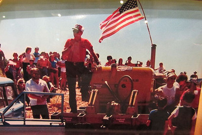 Sagebrush Rebellion: July 4, 1980. A group of 300 Grand County Utah residents gathered behind a flag-decorated bulldozer, in protest of the inclusion of Mill Creek Canyon as part of a BLM wilderness study area.