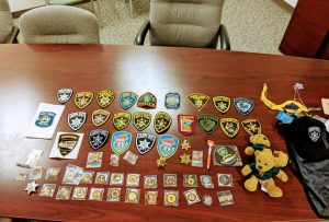 Some of the badges and pins sent Captain John Francis