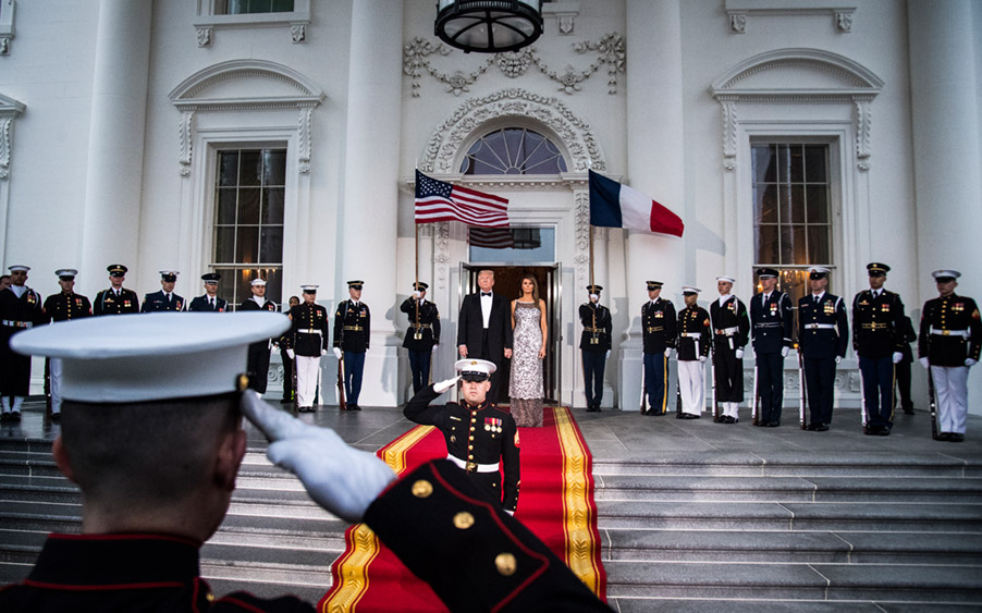 President Donald J. Trump and first lady Melania Trump walk out to the North Portico to greet French President Emmanuel Macron and his wife Brigitte Macron as the Trumps host a state dinner at the White House on Tuesday, April 24, 2018 in Washington, DC.