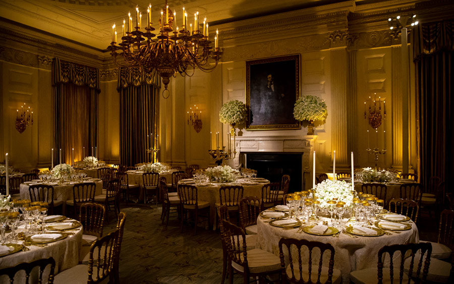 Dinner china is set before President Donald Trump and first lady Melania Trump host French President Emmanuel Macron and his wife, Brigitte Macron, for the first state visit of the Trump administration, in the State Dinning room of the White House.